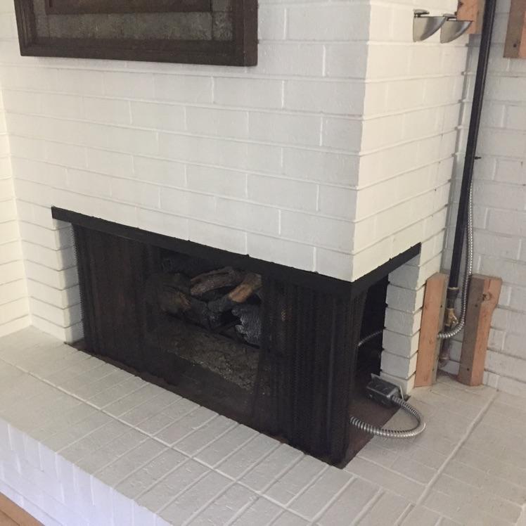 Kozy Heat Chaska 20 Rock Gas Insert In Corner Fireplace Before